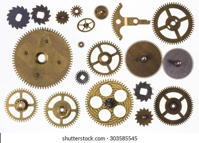 Selection of old brass clockwork clock parts - Isolated