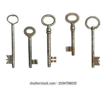 A selection of old-fashioned keys photographed on a white background.