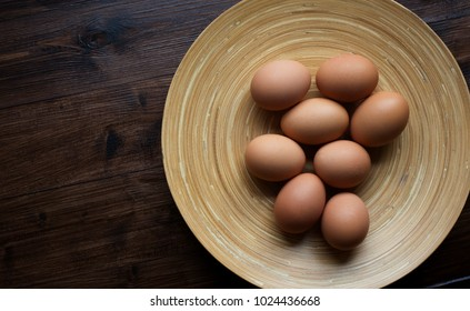 A selection of organic, brown eggs about to cooked at breakfast.