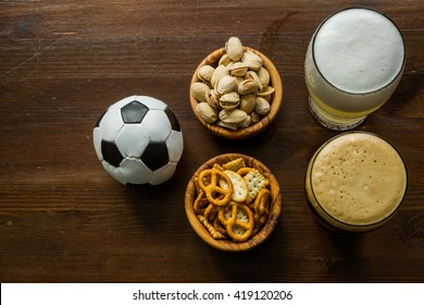 Selection of party food for watching football championship, copy space