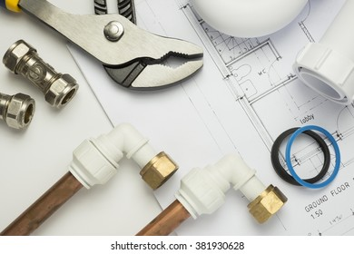 A selection of plumbing tools and fittings on architects plans