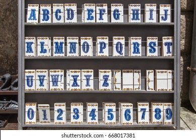 Selection of Portuguese ceramic tiles with alphabet and digits for house number signs