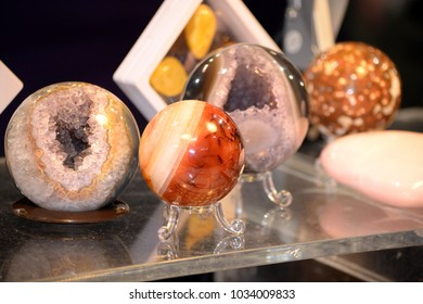 Selection of precious and semiprecious stones on the market. Mineral luxury design items for decorating.