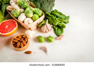 Selection of products to enhance the health and immunity: broccoli, mushrooms, mushrooms, Brussels sprouts, spinach, garlic, almonds and grapefruit, copy space