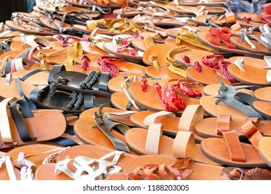 Selection of sandals on display on a market in Greece