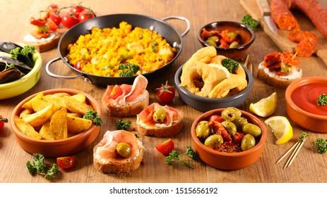selection of spanish tapas with olive, patatas bravas,calamari,mussel and paella