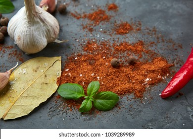 Selection of spices herbs. Ingredients for cooking, garlic and spices on dark stone table. Top view
