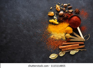 Selection spices, spicy and herbs in metal spoons, top view