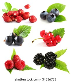 Selection of summer berry fruits including: blueberries, raspberries, black and red currants, wild strawberries, and blackberries with plant leaves.