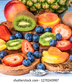 A selection of summer fruits including, sliced Strawberries, Kiwi Fruit, Nectarines, Pineapple and Blueberries.