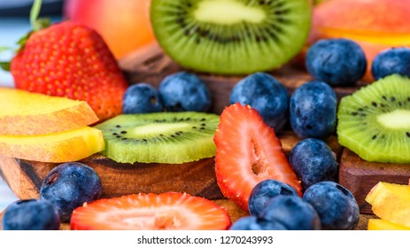 A selection of summer fruits including, sliced Strawberries, Kiwi Fruit, Nectarines and Blueberries.