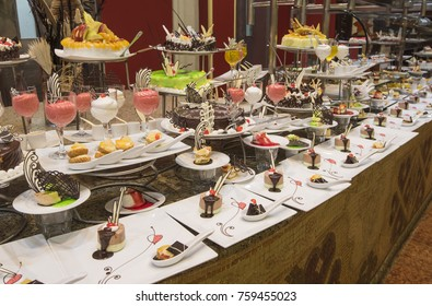 Selection of sweet desserts on display at a luxury restaurant food buffet bar
