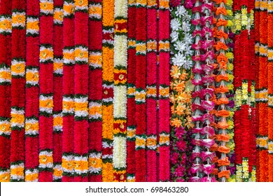 Selection of traditional Indian flower garlands used as offerings in Hindu religious ceremonies. Background