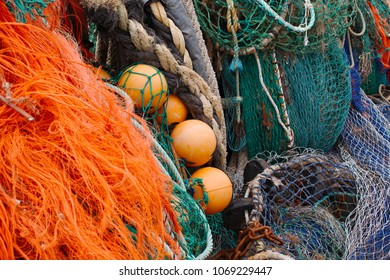 A selection of trawler (commercial) fishing equipment, including various nets, ropes and floats.