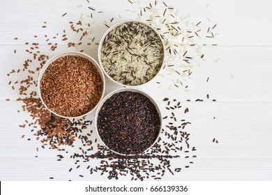 Selection of variety of gourmet rice in bowls. Top view with copy space