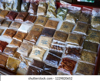 Selection of various packed spices on display in a street market Limassol Cyprus