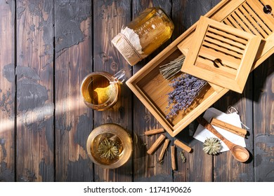 Selection of various tea types served with various spices: cinnamon, clove and cardamon decorated with tea serving tray and lavender. Top view