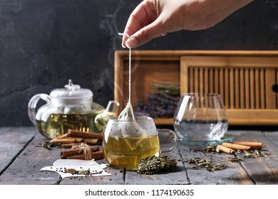 Selection of various tea types served with various spices: cinnamon, clove and cardamon decorated with tea serving tray and lavender