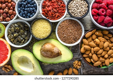 Selection of vegetarian food. Healthy superfoods, bio products for vegan diet with avocado, fruit and organic berries. Fresh nourishment on table. Breakfast in a bowls with different ingredients.