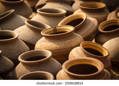 Selection of wheel-thrown neutral-colored Terracotta jars with slip decoration for sale at Jodhpur market, Rajasthan, India