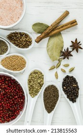 A selection of whole spices and seeds.