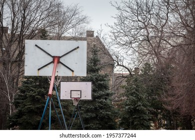 Selective blur on an Old, decaying damaged and rotten basketball backboard, in a decaying sports playground, standing during a cold winter.