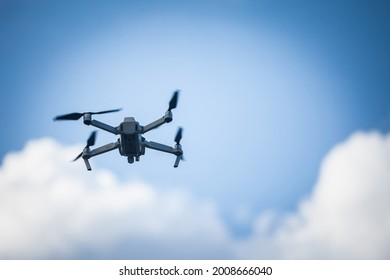 Selective blur on a Small unregistered consumer drone flying. These kind of small drones don't need license to be operated, as they are light and meant for beginners, amateurs and enthusiasts.