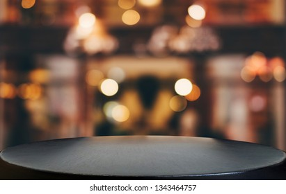 Selective Empty wooden table in front of abstract blurred festive light background with light spots and bokeh for product montage display of product.