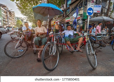 Selective focus. 01/21/2020 Myanmar (Burma) Yangon, taxi drivers resting waiting for new customers on their tricycle taxi also known as Saika. A popular form of transportation among the local poor