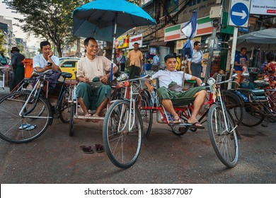 Selective focus, 01/21/2020 Myanmar (Burma) Yangon, taxi drivers resting waiting for new customers on their tricycle taxi also known as Saika. A popular form of transportation among the local poor