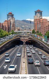 Selective focus. 06/05/2019 Tehran,Iran,Famous view of Tehran,Flow of traffic inside, above and nearby round Tohid Tunnel with Milad Tower and Alborz Mountains in Background,
