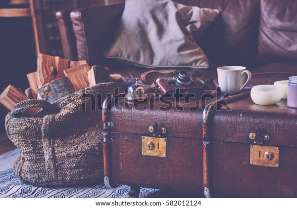 Selective focus and abstract photo. Cup coffee and old photo camera on vintage style interior background. Style retro.