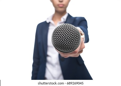 selective focus of anchorwoman taking interview with microphone