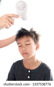 Selective focus at Asian boy has a hair dry by his mom.