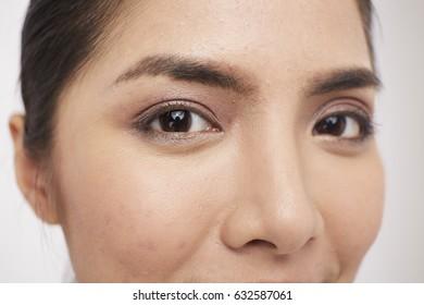 Selective focus of Asian girl eye on white background