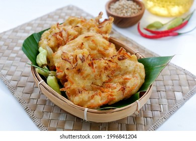 Selective focus Bakwan sayur or Bakwan Goreng or bala-bala or ote-ote is vegetebles fritter from Indonesia. Usually served with bumbu kacang or sambal or small chili pepper.