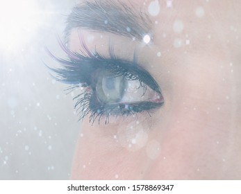 selective focus beautiful female eye close-up opposite light and tinting, looks away, vision correction concept, natural beauty with wrinkles, banner for lettering.