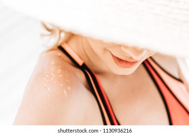 selective focus of beautiful young woman in wicker hat and swimwear