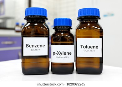 Selective focus of benzene, toluene and xylene liquid chemical compound in glass amber bottle inside a chemistry laboratory with copy space. BTX aromatic hydrocarbons used in petrochemical industry. - Shutterstock ID 1820092265