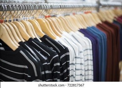 selective focus black Dress cloth and Shirts hanging stack,in the row