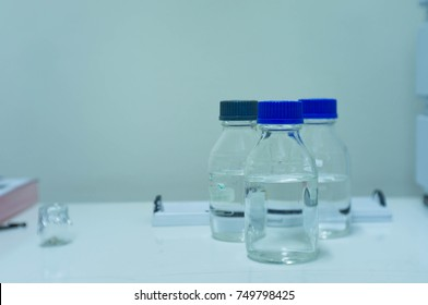 selective focus blue lid, the chemical liquid in bottle for high performance liquid chromatography (HPLC), analysis the food sample