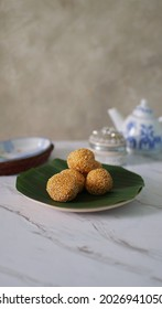"""selective focus with blur, A traditional Indonesian snack commonly called """"Onde Onde"""" or jiandui or sticky rice with green bean filling inside and this cake is coated with sesame seeds on the outside"""