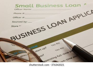 selective focus ,Business loan application form and Pen and glasses .