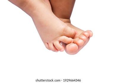selective focus at child's feet on white background, baby feet with copy space text