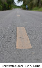 Selective focus and close up Perspective image of asphalt road with yellow traffic dashed line.