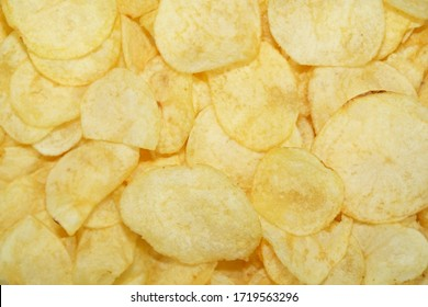 Selective focus Close up potato chips on wood top view background.