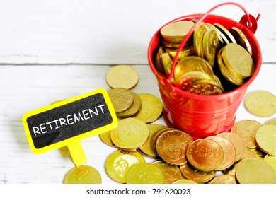 Selective focus of coins with blackboard written with 'RETIREMENT'. Retirement or pension theme.