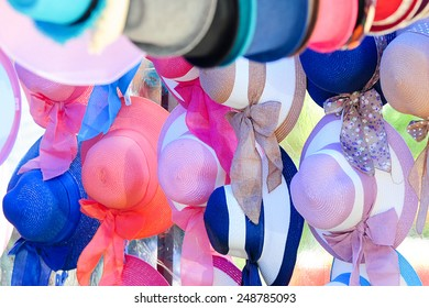 Selective focus of Colorful female summer hats on display