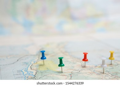 Selective focus of Colorful Many pins on map background