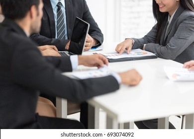 In selective focus of confident business team of mixed ages using labtop computer thegether for meeting in a modern office. They are discussing ideas for their business development.
